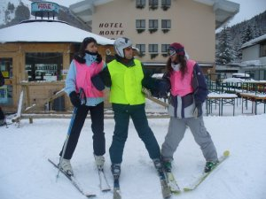 Guides and skier outside the hotel.