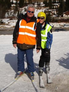 Guide and skier smiling.