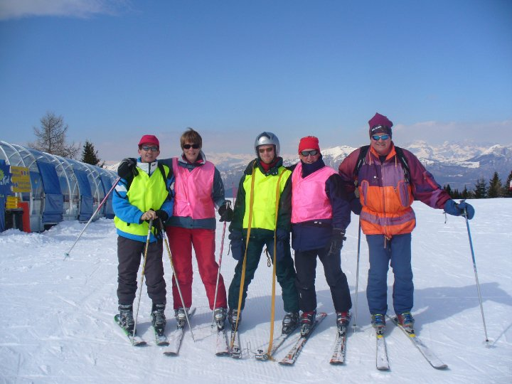Group of disabled skiers and Guides at the top of a mountain.
