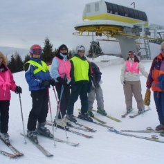Group of skiers by a chair lift.
